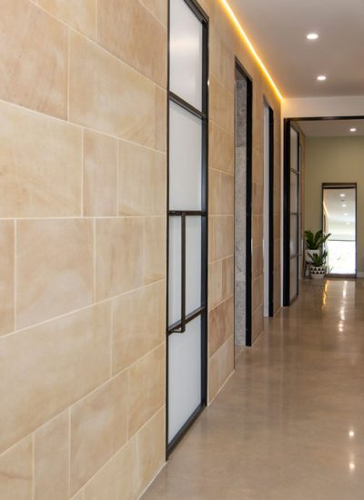 Polished Floor with sand stone walls